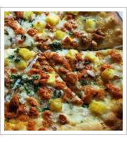 Pizza Al Pastor at Rulis International Kitchen
